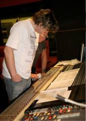 Darren with Ronnie Smith looking over music in recording studio.
